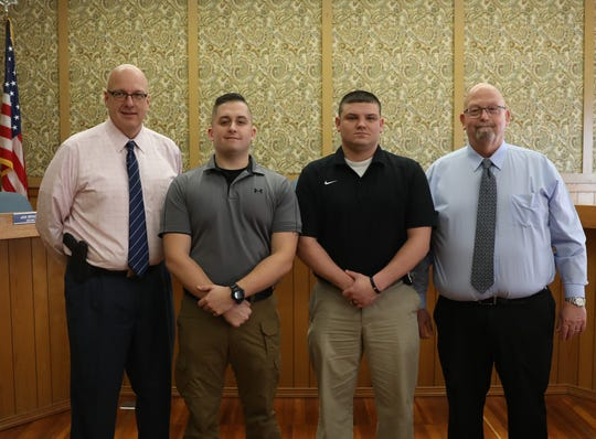 Zanesville Police Chief Tony Coury (left) and Mayor Jeff Tilton (far right) congratulate ZPD's newest officers, Justin Landerman and Derek Bragg. Patrolmen Landerman and Bragg were sworn in Monday afternoon before a host of family, fellow officers and city officials.