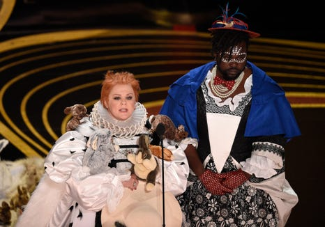 Melissa McCarthy, left, and Brian Tyree Henry present the award for best costume design at the Oscars on Feb. 24, 2019.