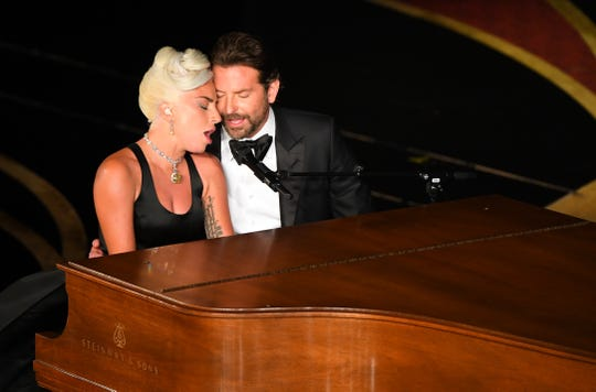 Lady Gaga and Bradley Cooper cozy up during their performance.