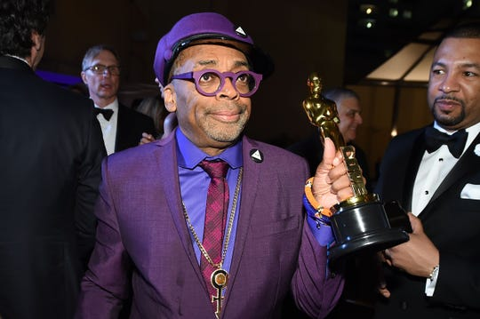 Spike Lee attends the 91st Annual Academy Awards Governors Ball with his Oscar for best adapted screenplay.