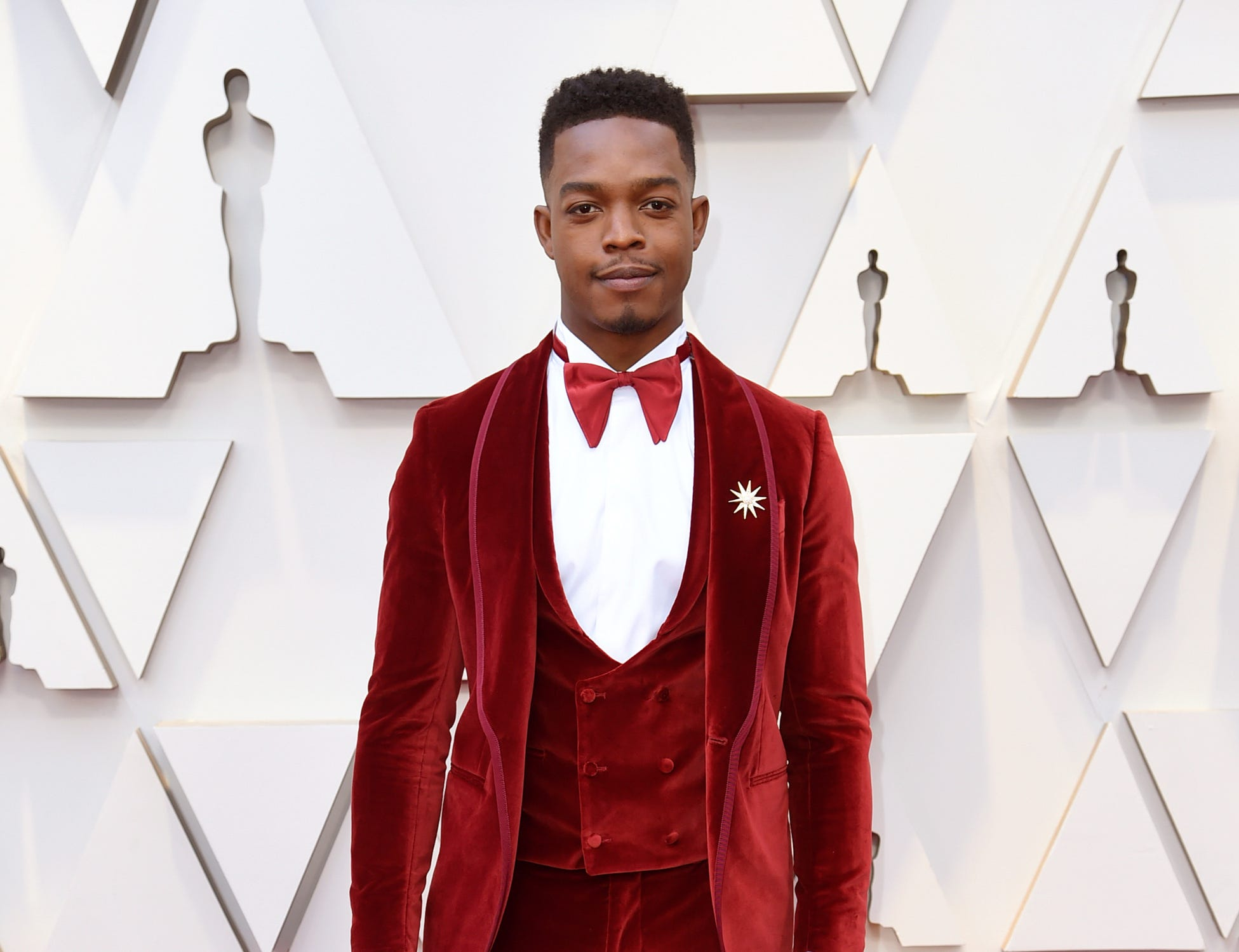 Stephan James arrives at the Oscars on Sunday, Feb. 24, 2019, at the Dolby Theatre in Los Angeles. (Photo by Richard Shotwell/Invision/AP) ORG XMIT: CACV530