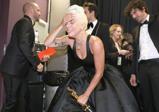 "An emotional Lady Gaga clutches her Oscar for best original song (for ""Shallow"") backstage."