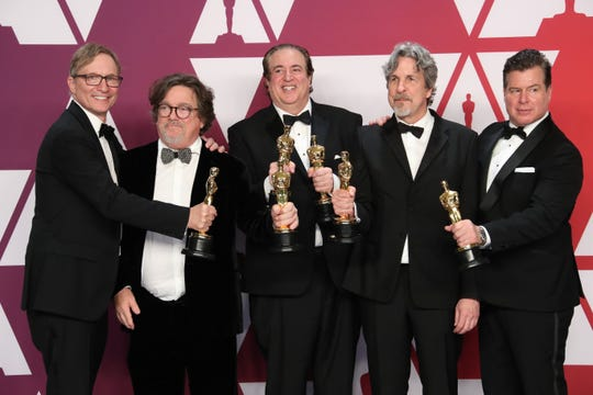 "Jim Burke (far left), Charles B. Wessler, Nick Vallelonga, Peter Farrelly and Brian Hayes Currie pose with their best picture Oscars for ""Green Book."""