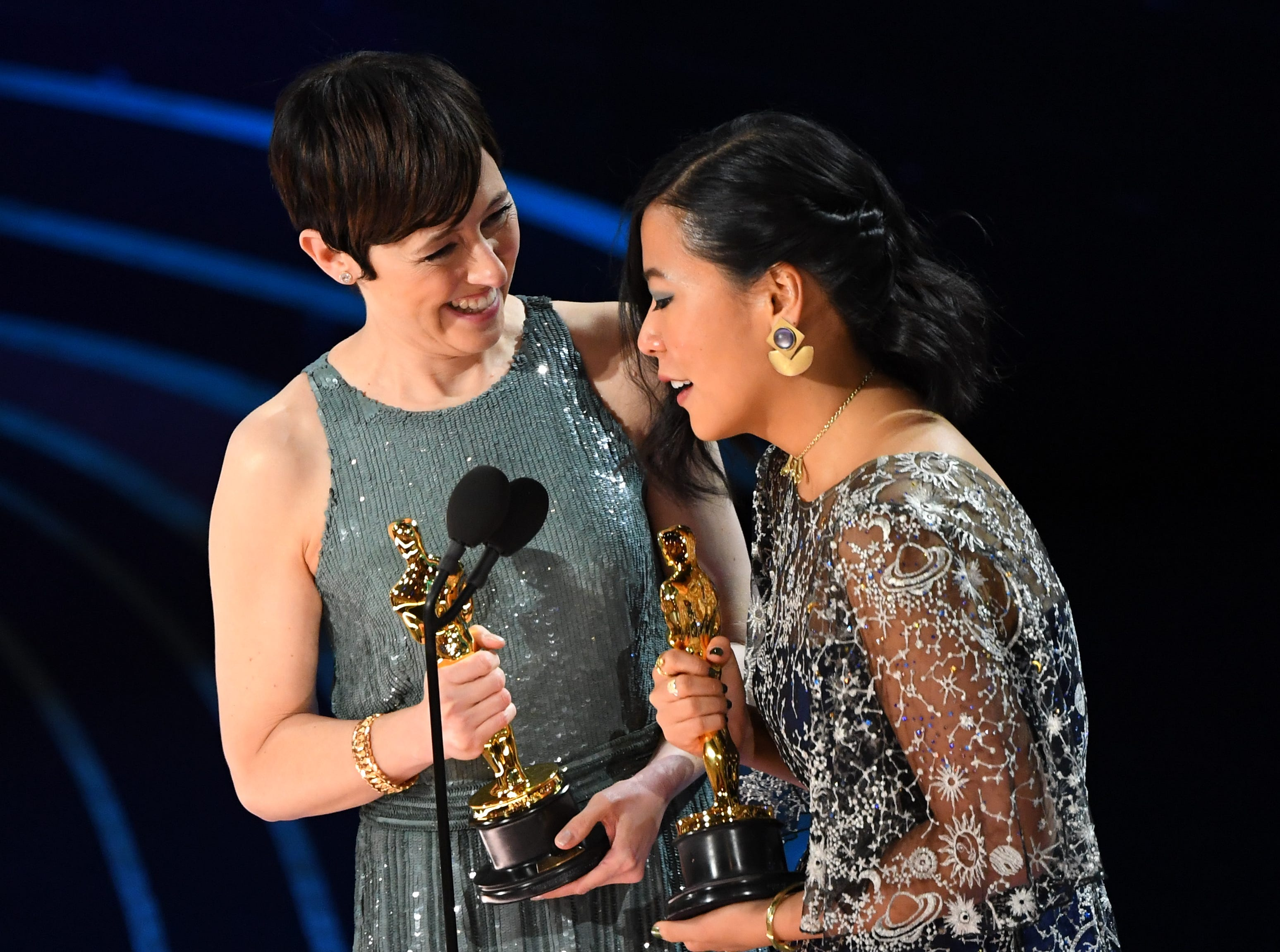 "Domee Shi and Becky Neiman-Cobb accept the award for best animated short film for ""Bao."""