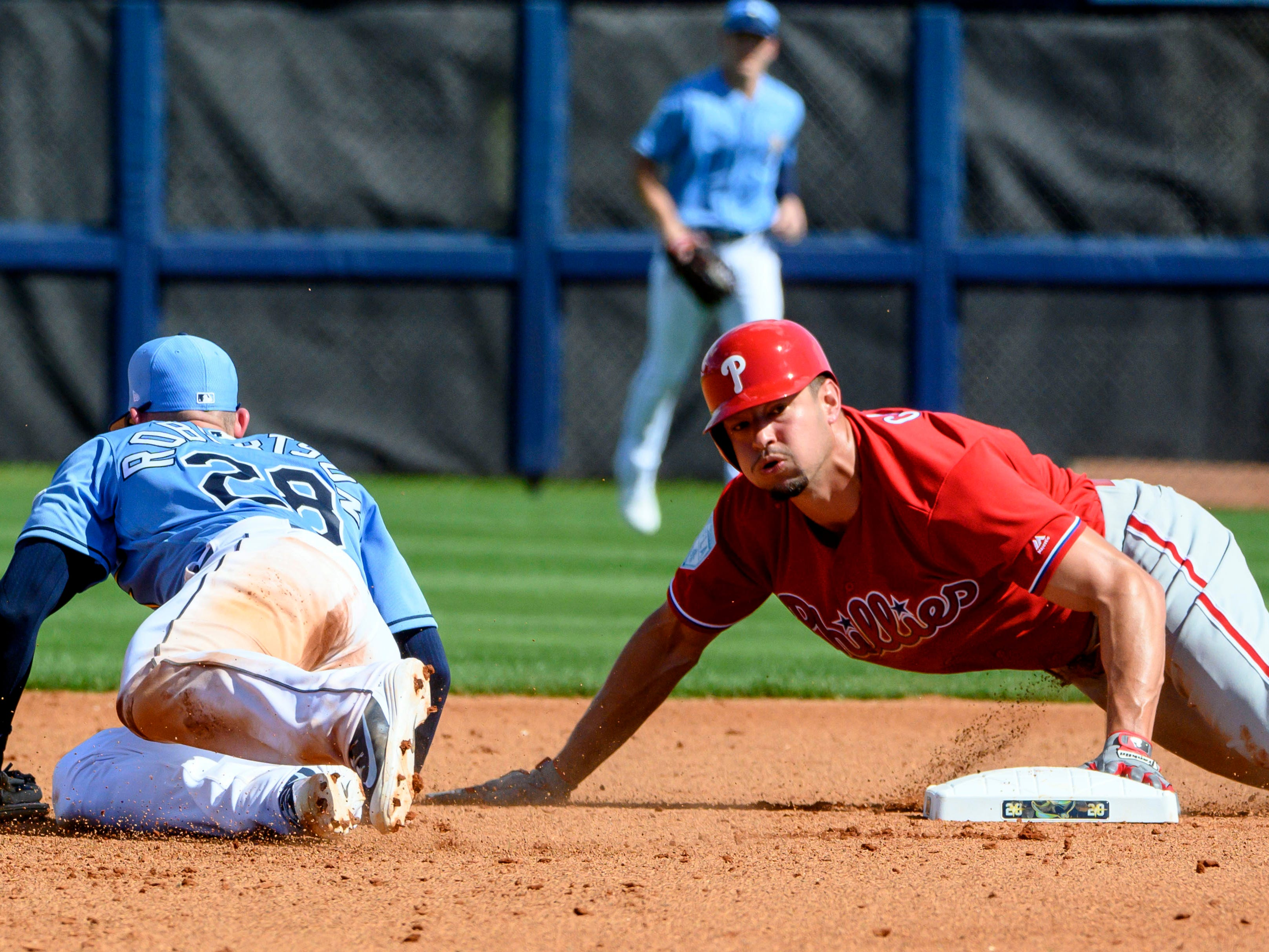 Feb. 22: Philadelphia Phillies right fielder Dylan Cozens steals second base in front of Tampa Bay Rays third baseman Daniel Robertson during the fourth inning at Charlotte Sports Park.