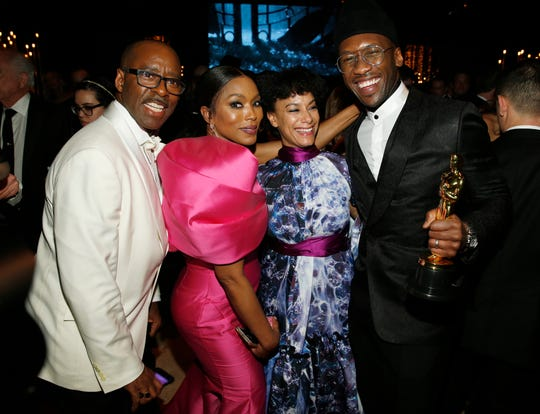 "Courtney B. Vance, from left, Angela Bassett, Amatus Sami-Karim and Mahershala Ali, winner of the award for best performance by an actor in a supporting role for ""Green Book,"" attend the Governors Ball after the Oscars on Sunday, Feb. 24, 2019, at the Dolby Theatre in Los Angeles. (Photo by Eric Jamison/Invision/AP) ORG XMIT: CADA707"