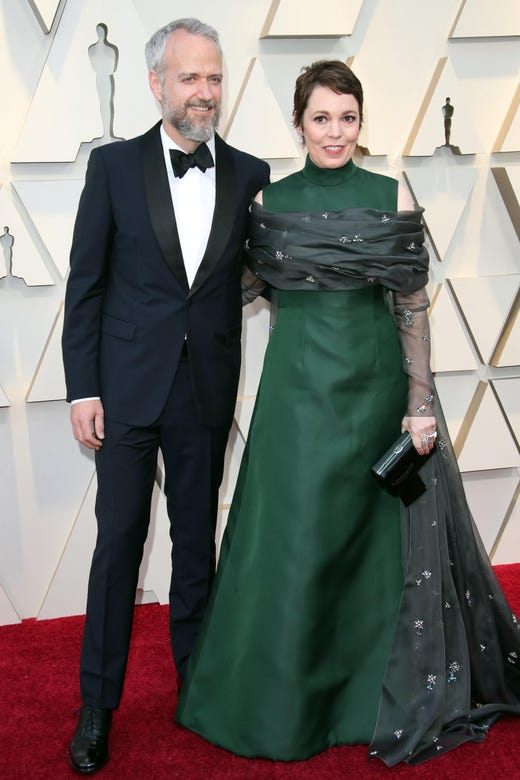 February 24, 2019; Los Angeles, CA, USA; Ed Sinclair, left, and Olivia Colman arrive at the 91st Academy Awards at the Dolby Theatre. Mandatory Credit: Dan MacMedan-USA TODAY NETWORK