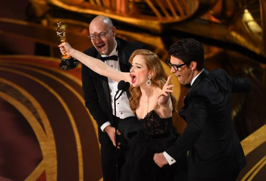 """Guy Nattiv and Jaime Ray Newman accept the award for best live action short film for """"Skin."""""""