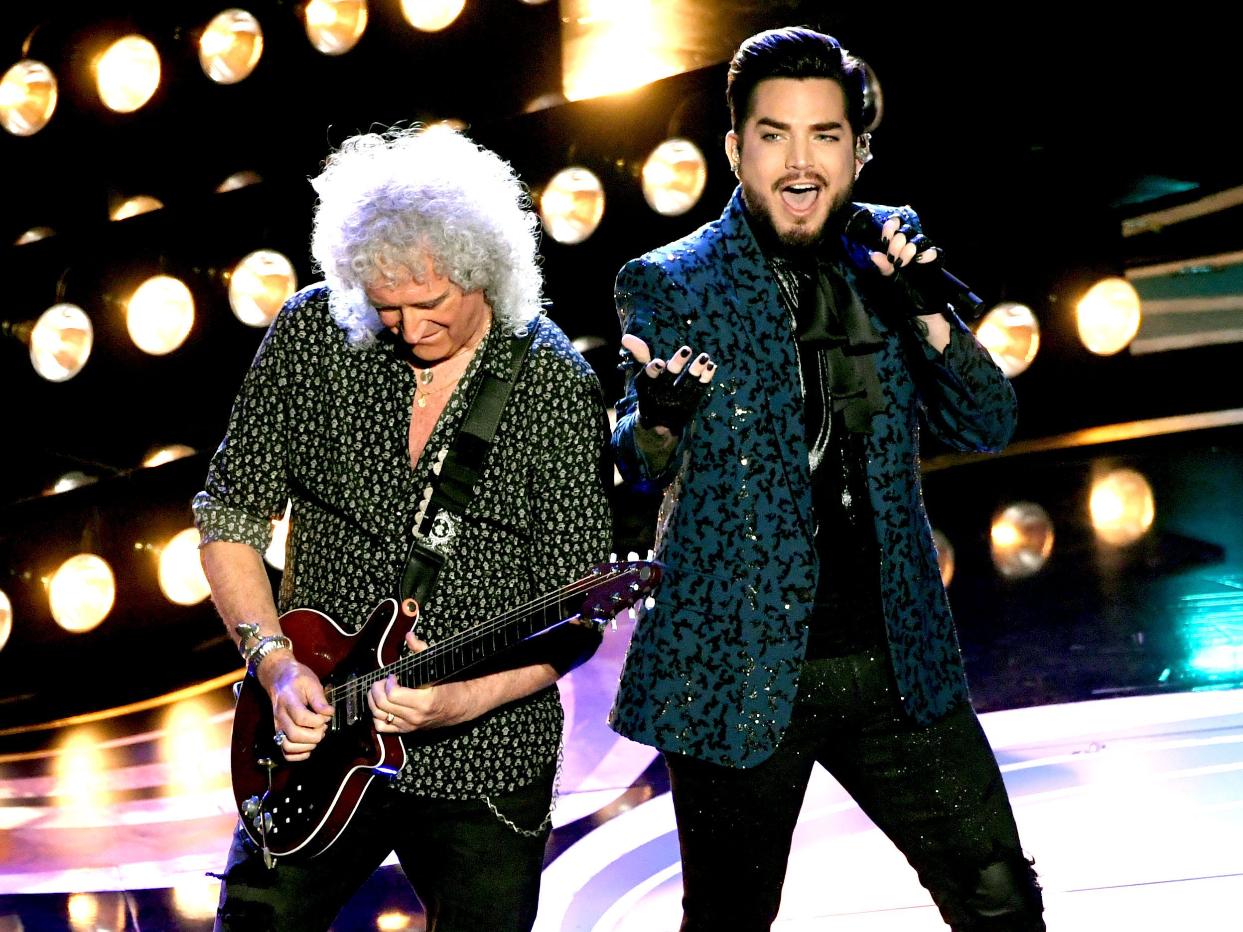 Opening act Queen and Adam Lambert had Oscar winners acting like kids at their first concert.