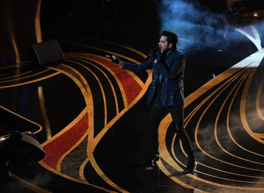 Adam Lambert performs with Queen during the show.