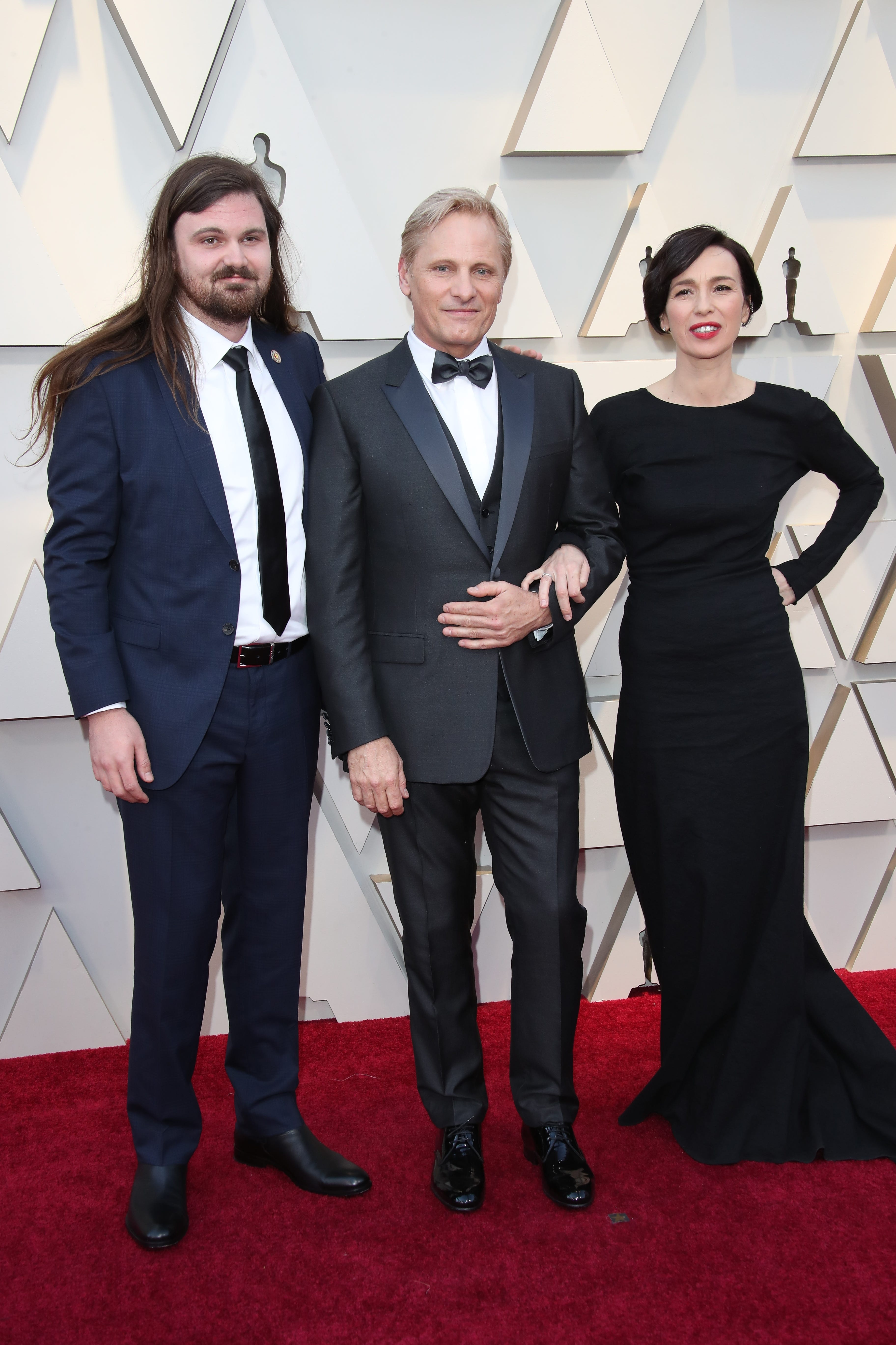 February 24, 2019; Los Angeles, CA, USA; Henry Mortensen, from left, Viggo Mortensen, and Ariadna Gil arrive at the 91st Academy Awards at the Dolby Theatre. Mandatory Credit: Dan MacMedan-USA TODAY NETWORK (Via OlyDrop)