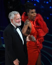 """Hannah Beachler and Jay Hart accept the award for achievement in production design for """"Black Panther""""  during the 91st Academy Awards at the Dolby Theatre."""