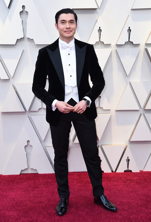 Henry Golding arrives at the Oscars on Sunday, Feb. 24, 2019, at the Dolby Theatre in Los Angeles. (Photo by Richard Shotwell/Invision/AP) ORG XMIT: CACV552