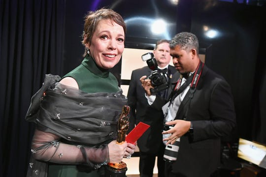 "Teary-eyed, Olivia Colman arrives backstage with her best actress Oscar (for ""The Favourite"") in hand."