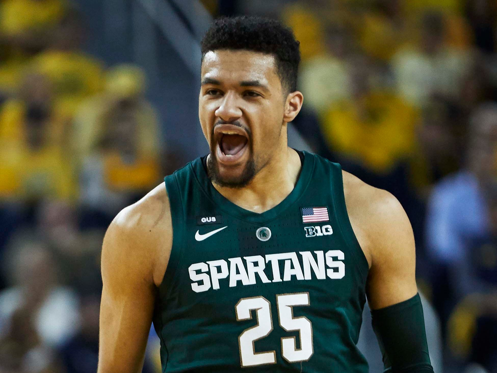 Michigan State Spartans forward Kenny Goins (25) reacts after he makes a three point basket.