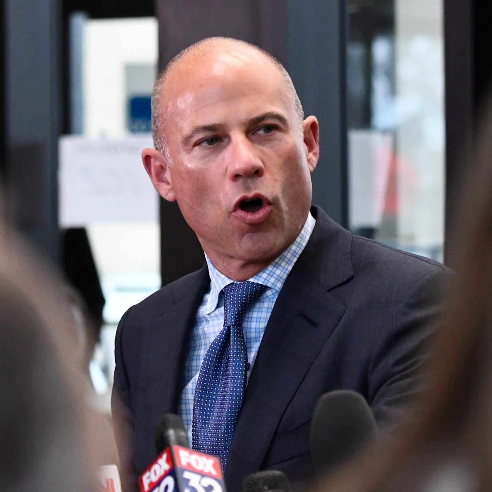 Attorney Michael Avenatti, seen here following R. Kelly's first court appearance Saturday, says he has another sex tape of the singer with an underage girl.