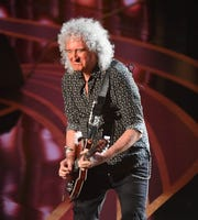 Brian May of Queen performs during the show.