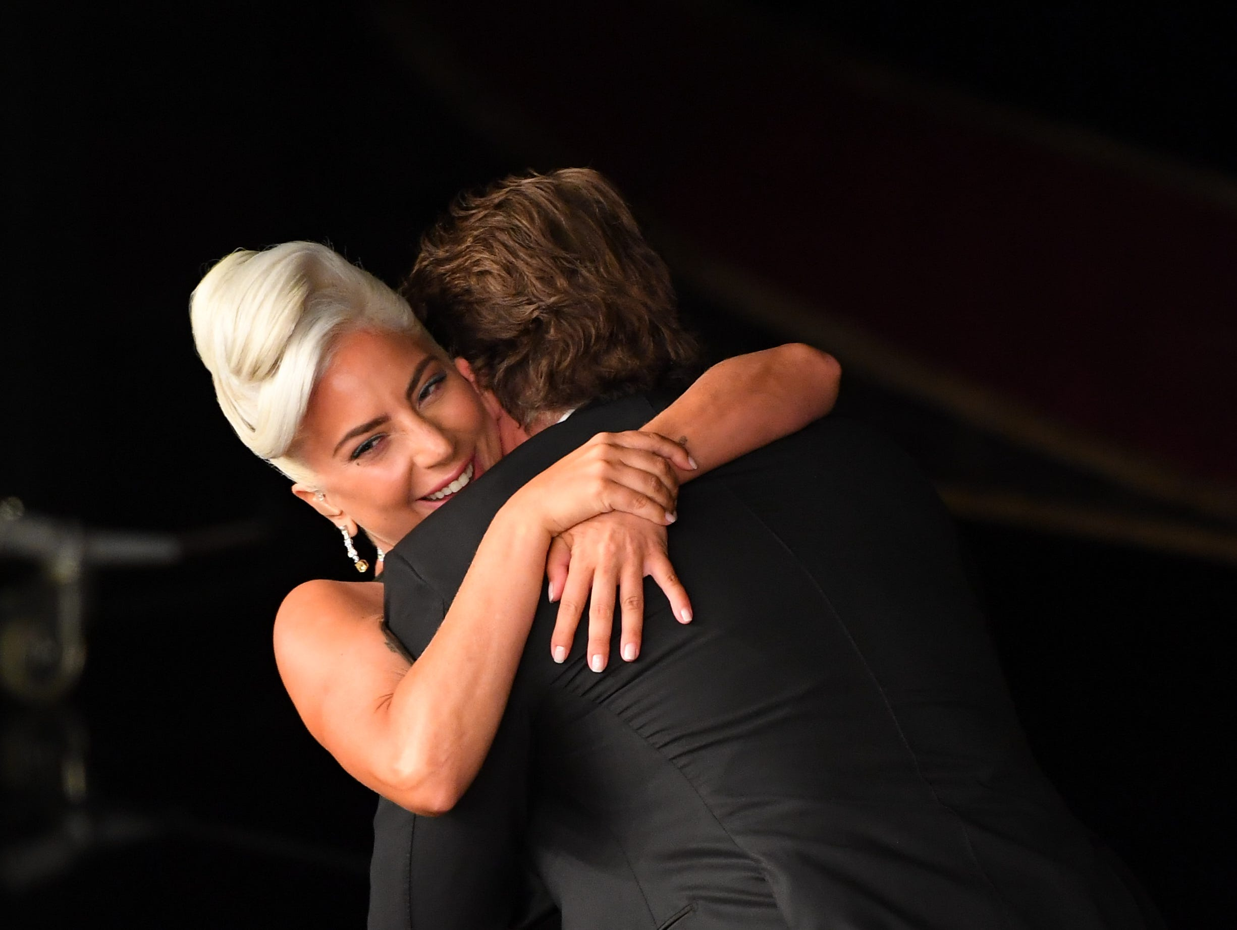 Lady Gaga and Bradley Cooper after their performance during the show.