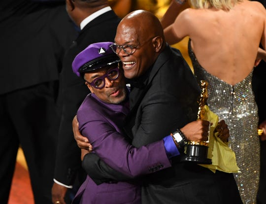 "Spike Lee celebrates with Samuel L. Jackson after accepting the Oscar for best adapted screenplay for ""BlacKkKlansman."""