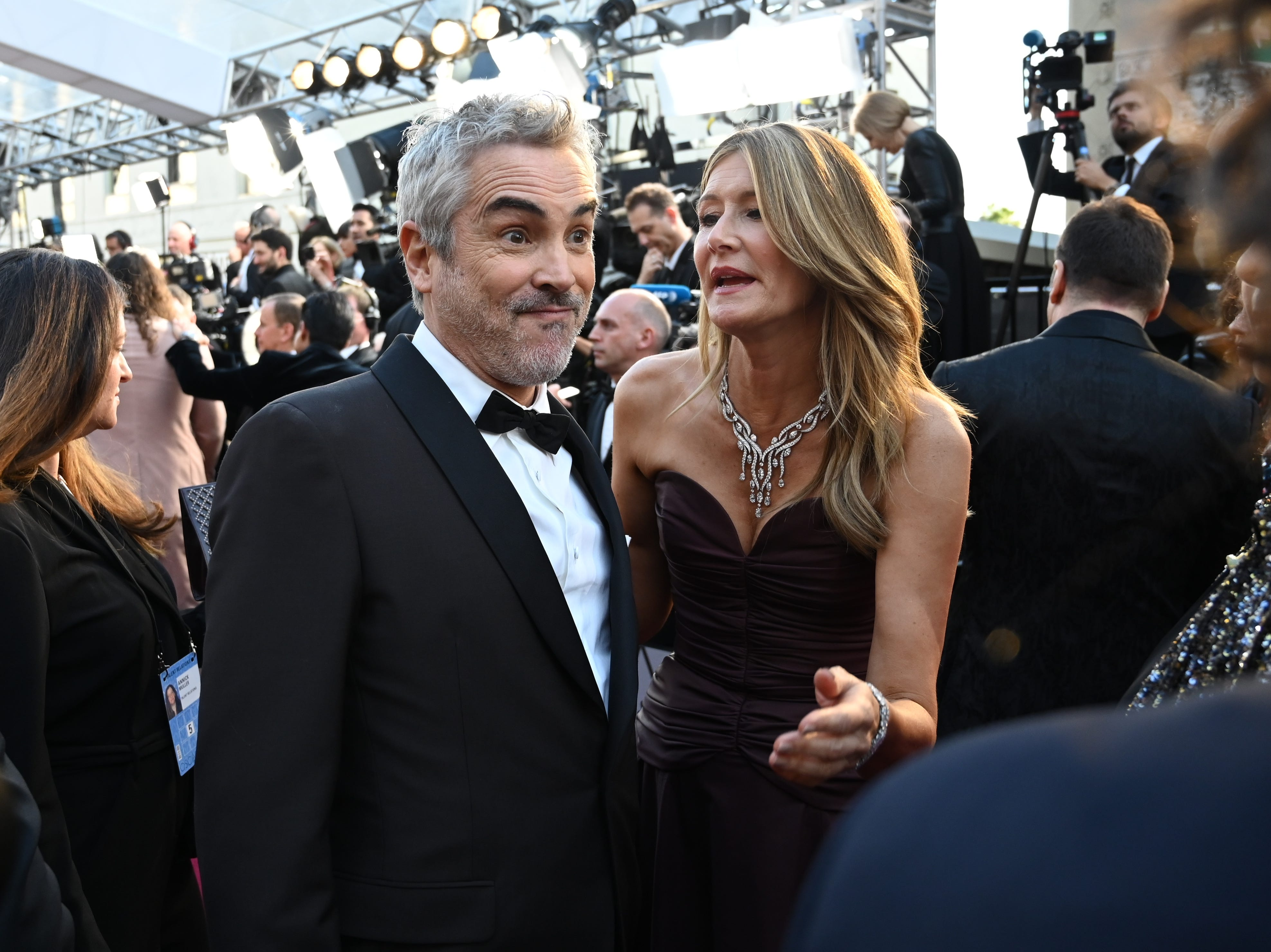 February 24, 2019; Los Angeles, CA, USA; Alfonso Cuaron and Laura Dern arrive at the 91st Academy Awards at the Dolby Theatre. Mandatory Credit: Robert Hanashiro-USA TODAY NETWORK (Via OlyDrop)