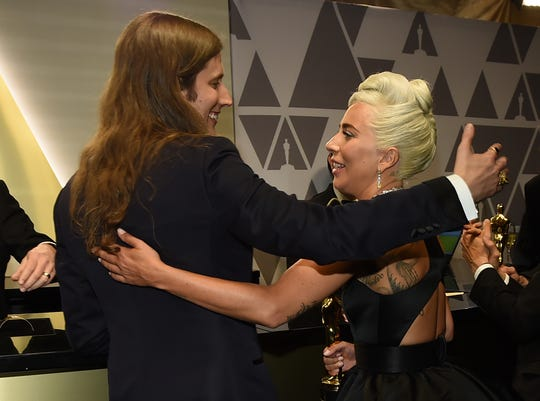 Lady Gaga and Ludwig Goransson, winners for the respective best song and best score, embraced in the engraving room at the Oscar after-party.
