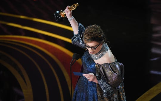 "Ruth Carter accepts the award for achievement in costume design for ""Black Panther."""