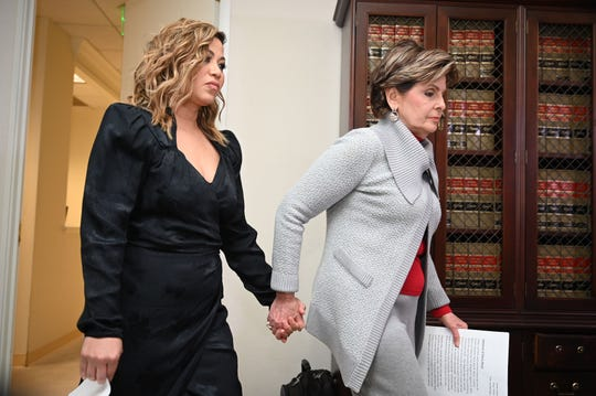 Lizzette Martinez, an accuser of R. Kelly, with her attorney Gloria Allred at a press conference in Allred's office in Los Angeles, Feb. 25, 2019.