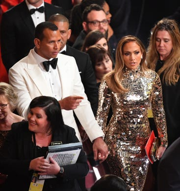 Look who got engaged! Alex Rodriguez and Jennifer Lopez arrive hand in hand at the 91st Academy Awards in Los Angeles, less than two weeks before he popped the question during a romantic beach getaway.