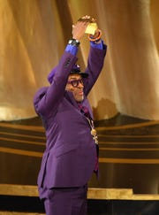 """Spike Lee celebrates as he accepts the award for best adapted screenplay for """"BlacKkKlansman""""   during the 91st Academy Awards."""