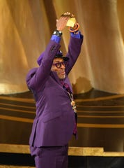 "Spike Lee celebrates as he accepts the award for best adapted screenplay for ""BlacKkKlansman""   during the 91st Academy Awards."