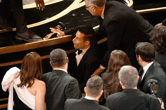 Rami Malek takes a tumble at the Academy Awards on Feb. 24, 2019.