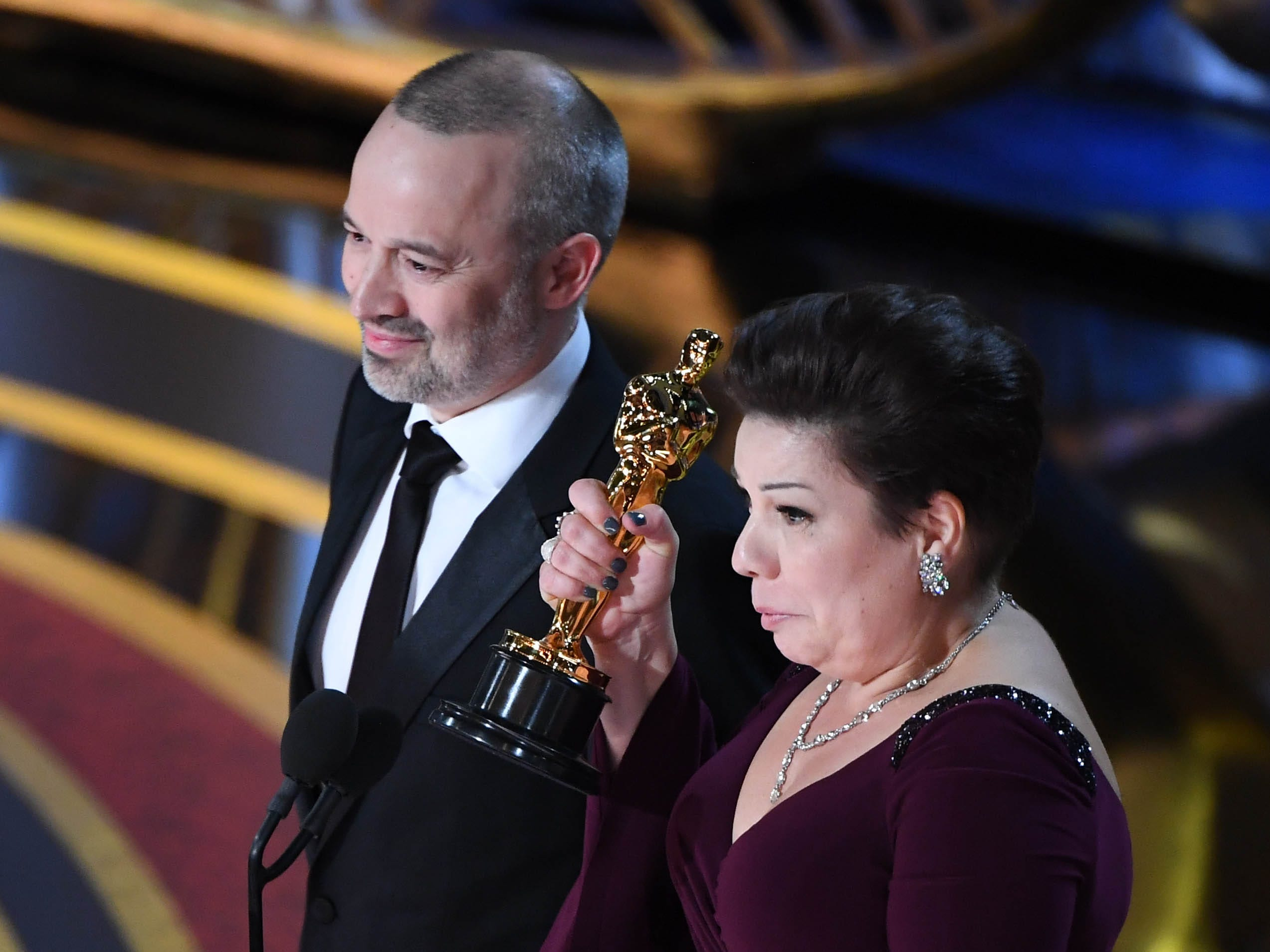 "John Warhurst and Nina Hartstone accept the award for achievement in sound editing for ""Bohemian Rhapsody."""