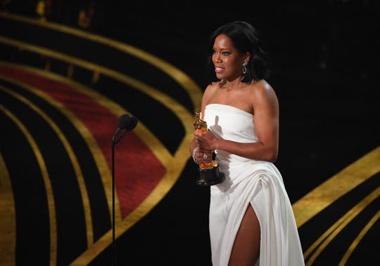 """Regina King accepts for best performance by an actress in a supporting role for her role in """"If Beale Street Could Talk"""" during the 91st Academy Awards at the Dolby Theatre."""