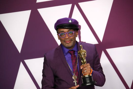 It's purple reign, as Spike Lee shows off his Oscar for best adapted screenplay for 'BlacKkKlansman.'