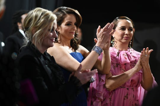"Before Amy Poehler (left), Tina Fey and Maya Rudolph walked out to present best supporting actress (to Regina King of ""If Beale Street Could Talk""), they huddled backstage over an iPad to practice their lines."