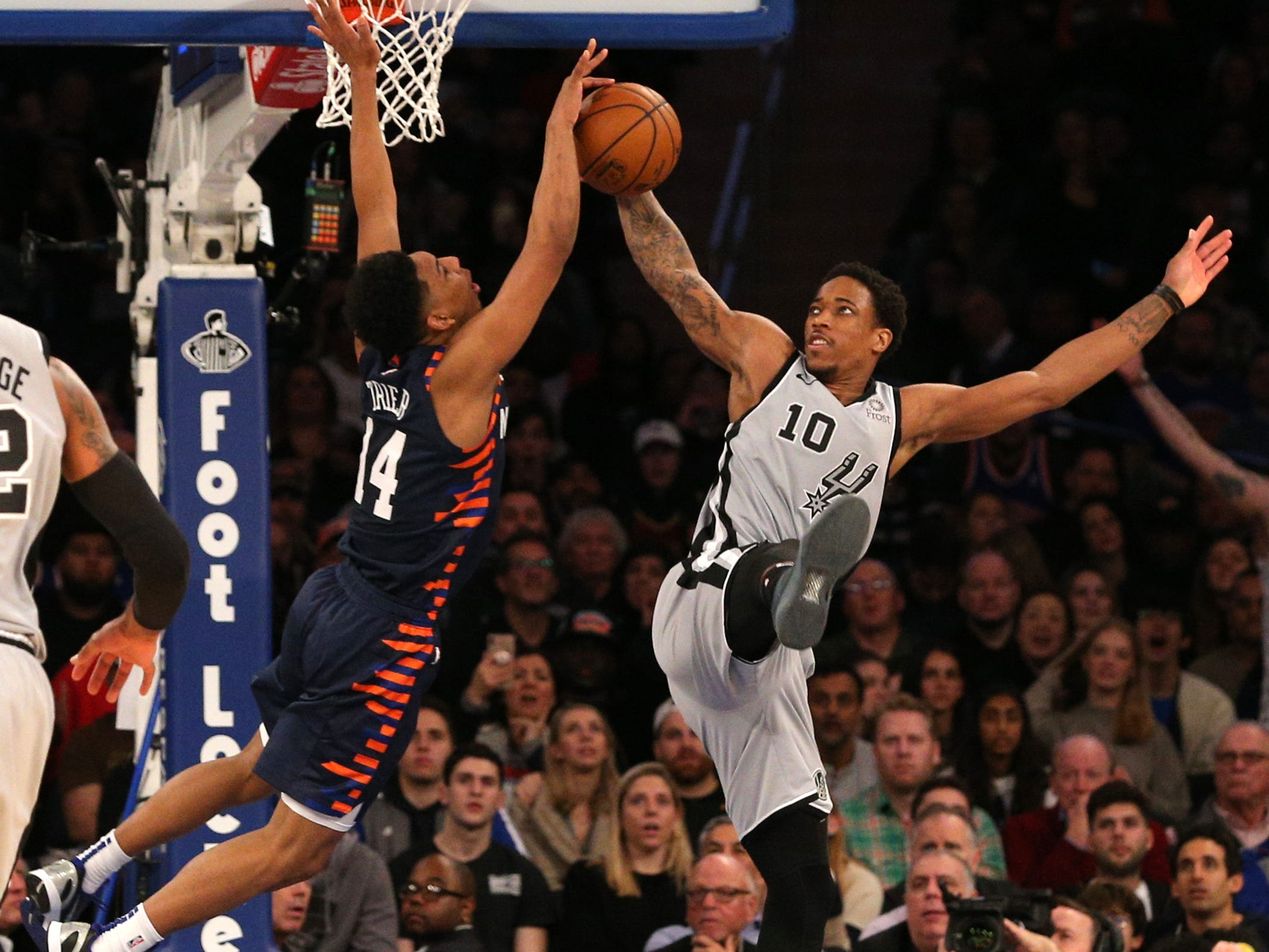 Feb. 24: Spurs guard DeMar DeRozan fouls Knicks guard Allonzo Trier (14) on a wilde drive to the hoop at Madison Square Garden.