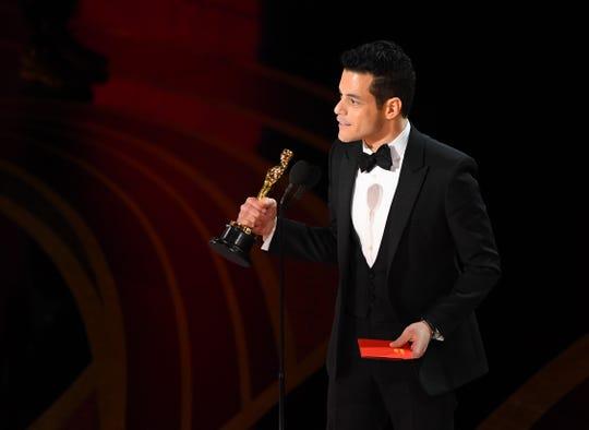 Rami Malek accepts the best actor Oscar for his portrayal of Freddie Mercury in 'Bohemian Rhapsody.'
