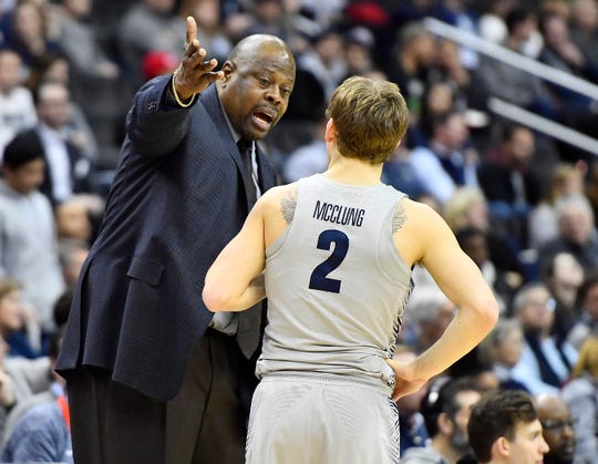 Georgetown coach Patrick Ewing talks with Hoyas guard Mac McClung.