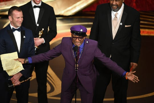 "A jubilant Spike Lee accepts the Oscar for best adapted screening for ""BlacKkKlansman."""