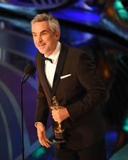 """Alfonso Cuaron accepts best cinematography for Netflix's """"Roma,"""" which also won best foreign-language film at the 91st Academy Awards."""