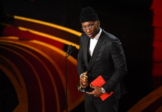 """Mahershala Ali accepts the award for best supporting for """"Green Book"""" during the 91st Academy Awards."""
