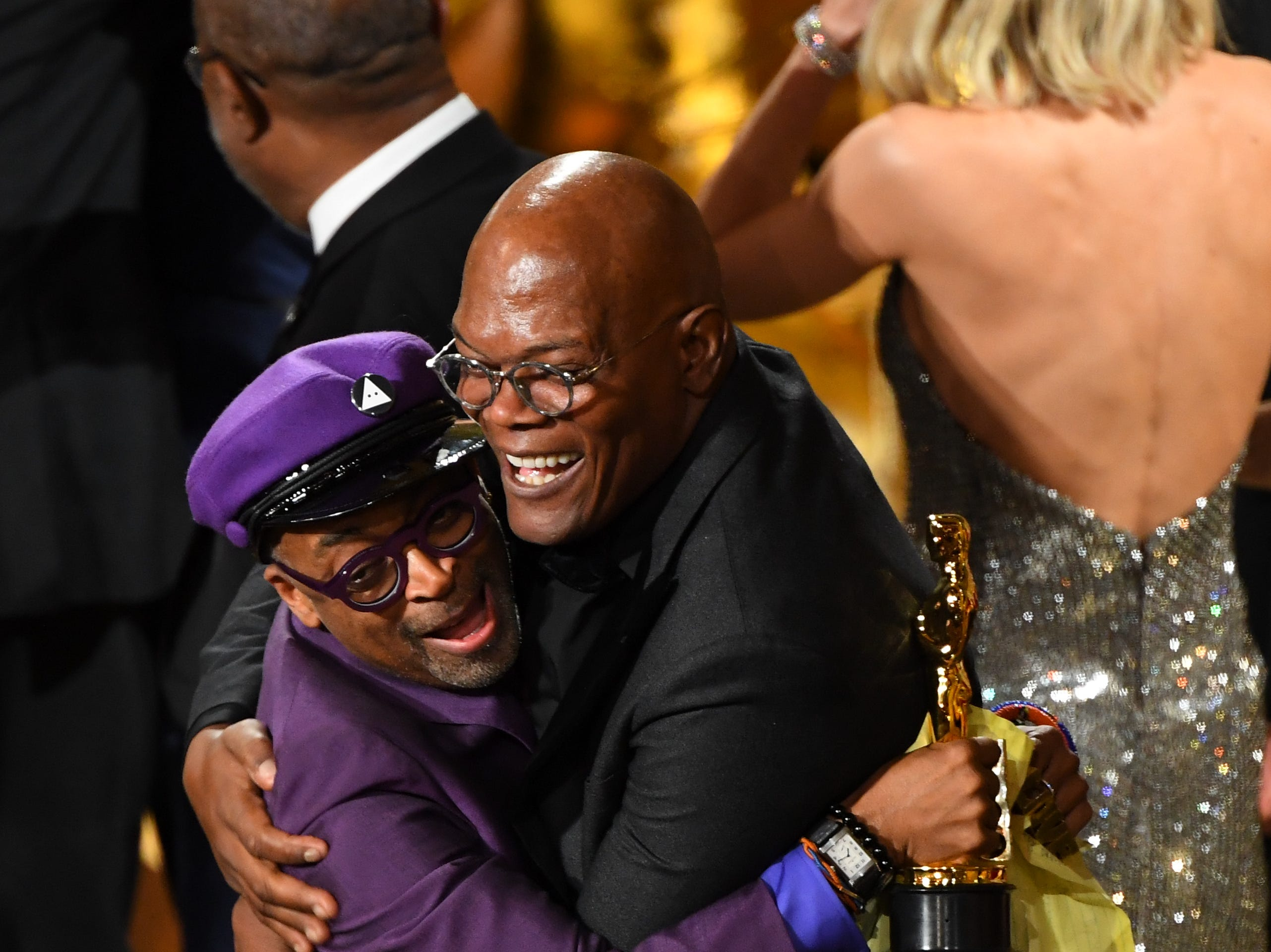 "Spike Lee celebrates with Samuel L. Jackson after he accepts the award for best adapted screenplay for ""BlacKkKlansman."""