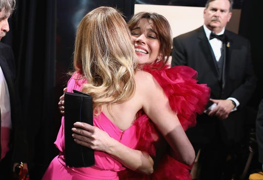 "Julia Roberts hugs Linda Cardellini backstage after ""Green Book"" won best picture at the Oscars."