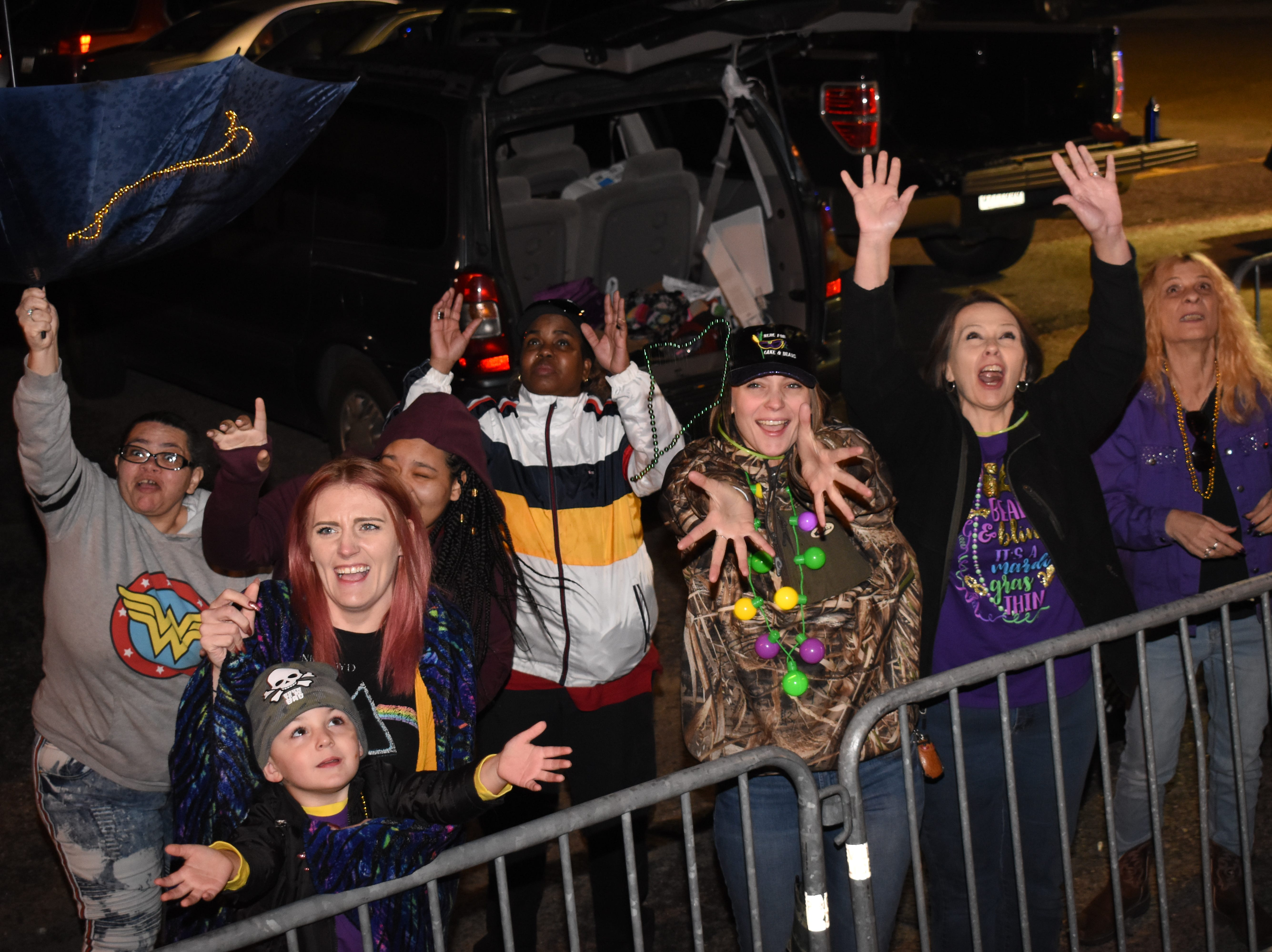 Crowds yell for throws at Pineville's  2019 Light the Night Parade held Monday, Feb. 25, 2019. The parade started in Pineville near Louisiana College and ended in downtown Alexandria. The parade was postponed last Friday due to weather.