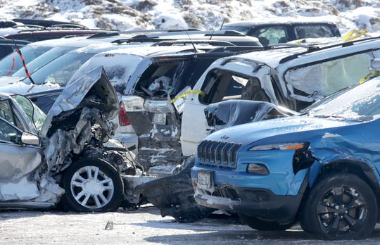 """Vehicles are stored in a lot at the Neenah city garage on Monday, February 25, 2019, in Neenah Wis. The vehicles were towed to the lot aftrer one person was killed and dozens of drivers were stranded following a pileup of more than 100 cars on Interstate 41 on Sunday, February 24, 2019. Whiteout conditions caused the """"chain reaction crash"""" at 11:10.Wm. Glasheen/USA TODAY NETWORK-Wisconsin."""