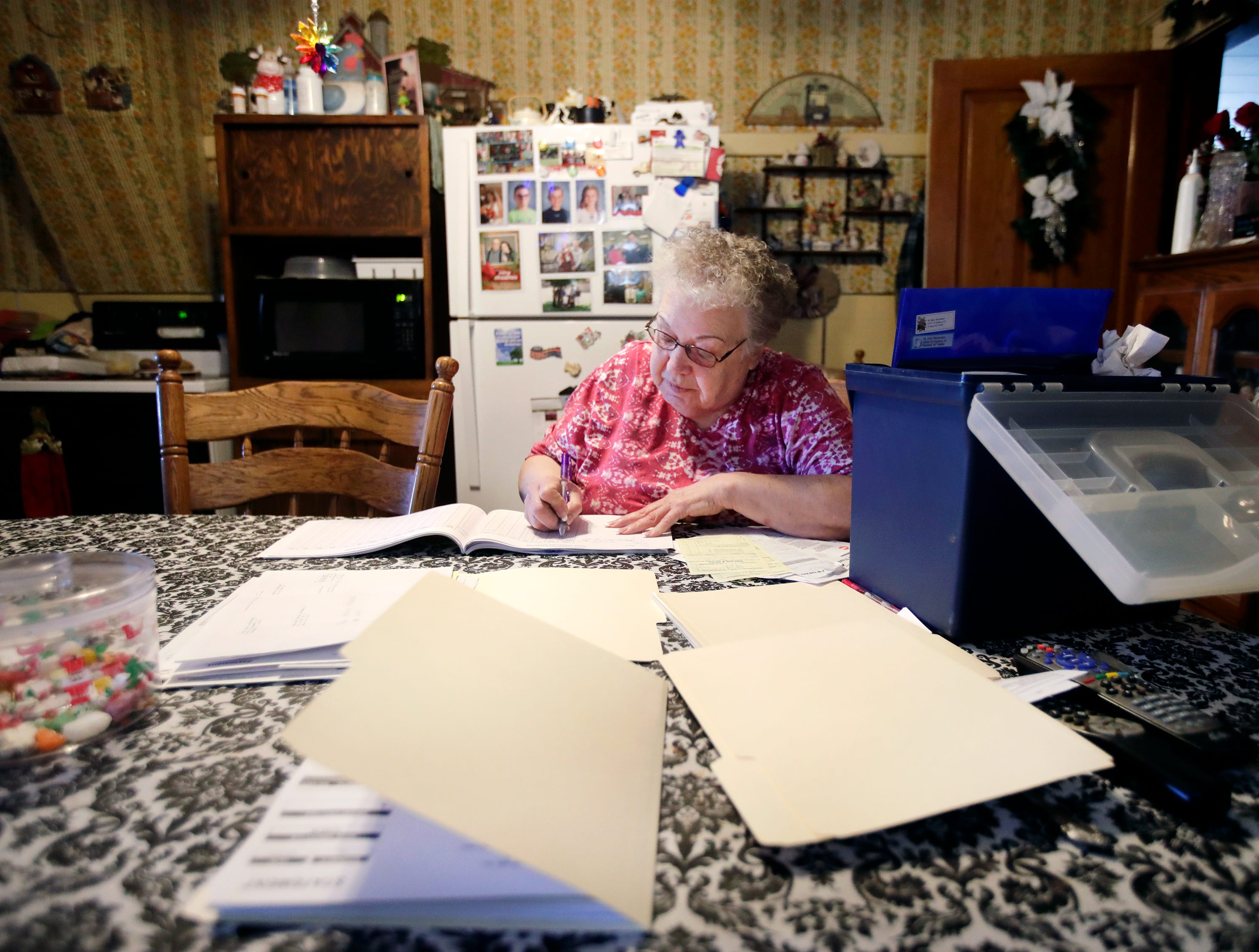 Mary Rieckmann documents farm expenses at her kitchen table while her husband, John, and sons do daily chores around their dairy farm Wednesday Feb. 13, 2019, in Fremont, Wis.Danny Damiani/USA TODAY NETWORK-Wisconsin