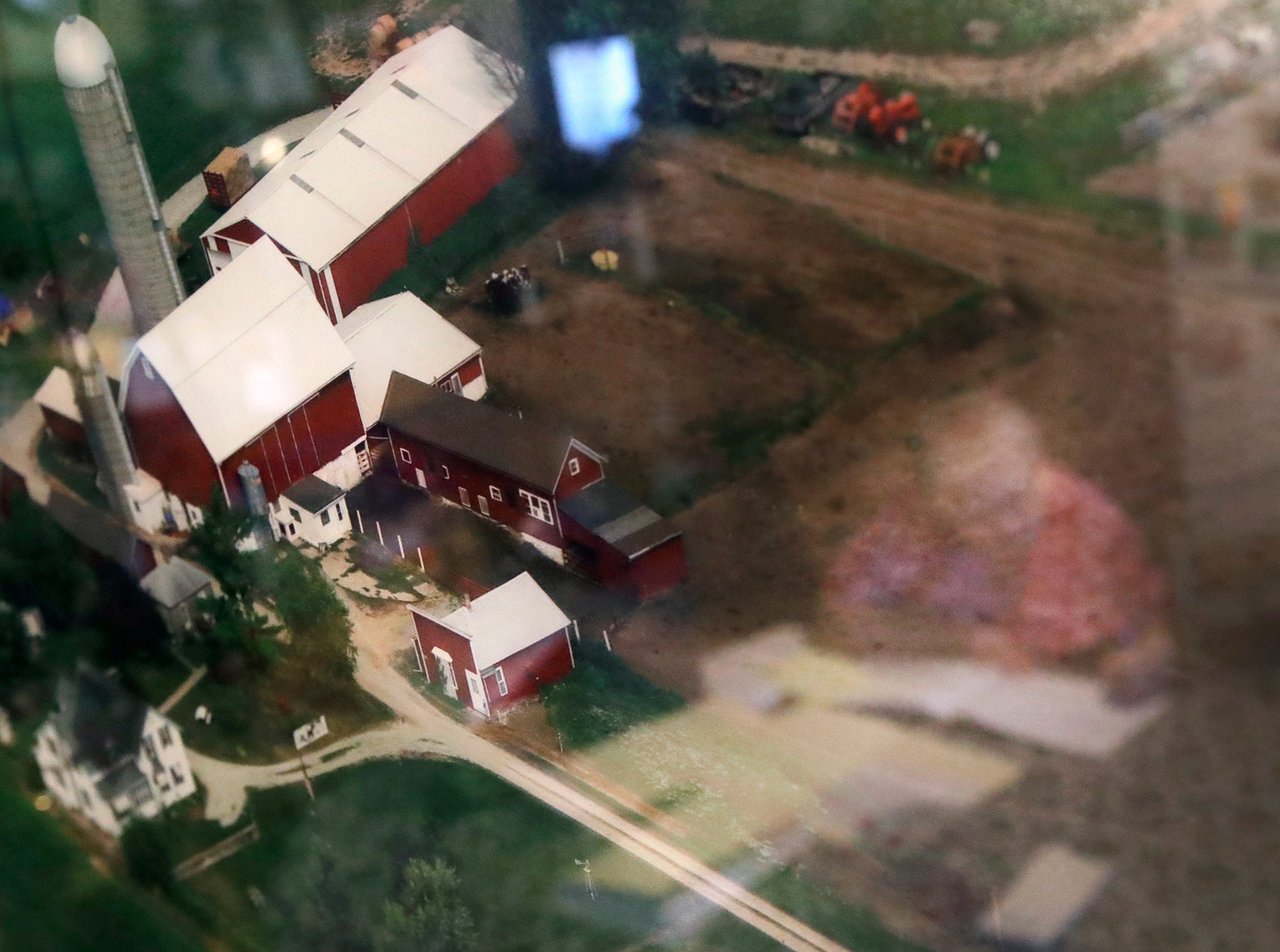 Mary Rieckmann is reflected in an aerial photo of her dairy that hangs on her kitchen wall as she documents farm expenses Wednesday Feb. 13, 2019, in Fremont, Wis.Danny Damiani/USA TODAY NETWORK-Wisconsin