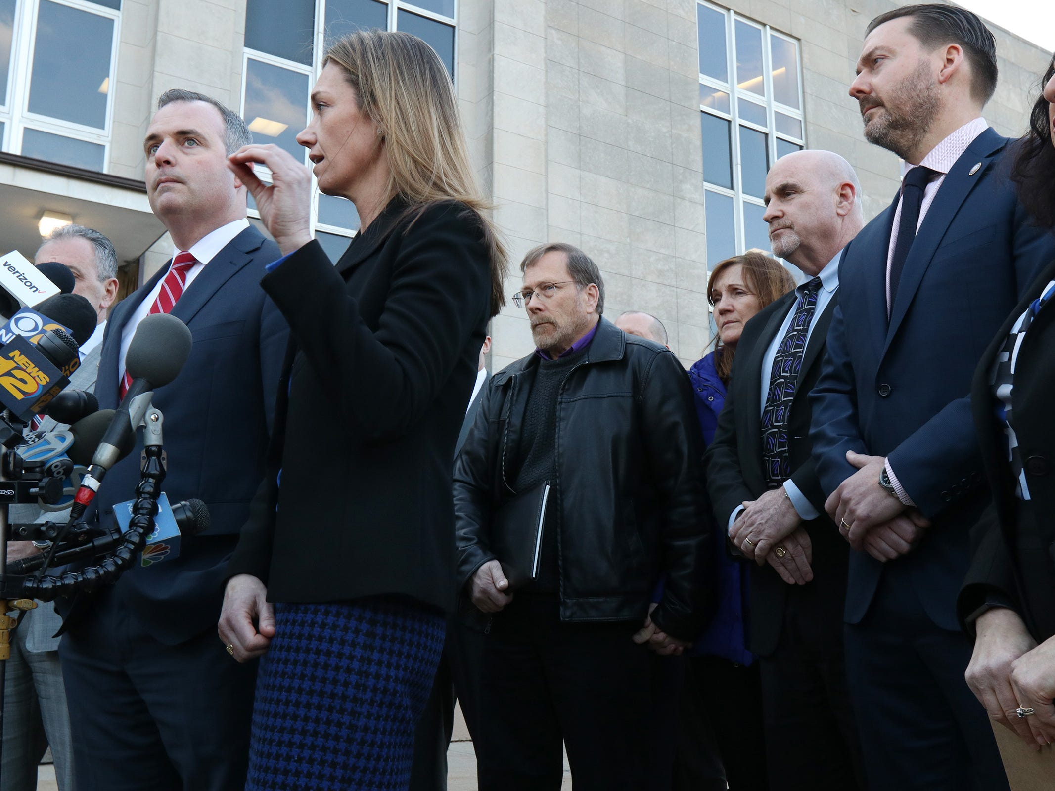 (center) Michael Stern, father of Sarah Stern, holds the hand of his girlfriend, Kristine Eckert, as Christopher Decker and Meghan Doyle, both assistant Monmouth County prosecutors, speak during a press conference after the the jury found Liam McAtasney guilty on all charges in the murder of former high school classmate, Sarah Stern, at the Monmouth County Courthouse in Freehold, NJ Tuesday, February 26, 2019.