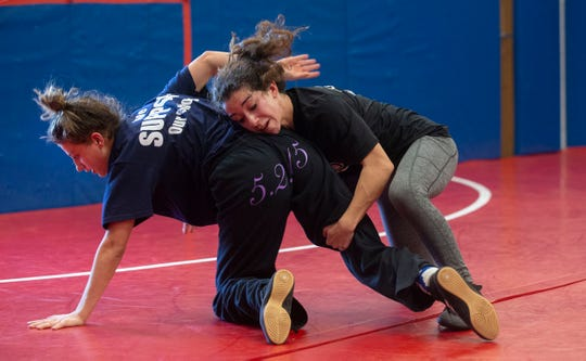 Julia Manolas and Jasmine Aizley work on moves. Manalapan and Allentown girl wrestlers practice as they prepare for this weekend's  state tournament in Atlantic City.