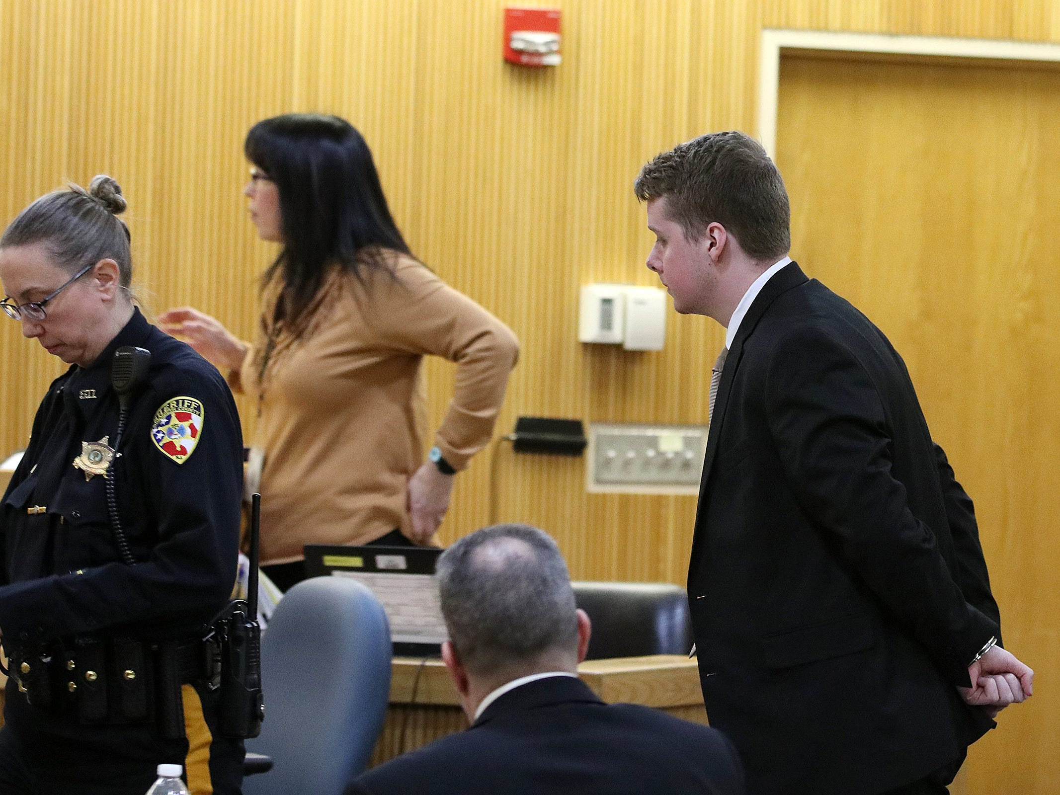 Liam McAtasney, who was found guilty of all charges in the murder of former high school classmate, Sarah Stern, is lead out of the courtroom in handcuffs after the verdict was read before Superior Court Judge Richard W. English at the Monmouth County Courthouse in Freehold, NJ Tuesday, February 26, 2019.